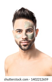 Handsome man with clay mask on his face against white background