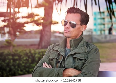 Handsome man in cool jacket wearing sunglasses