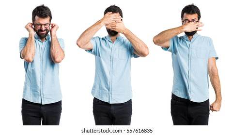 Handsome man covering his face, ears and nose