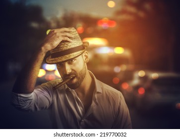 Handsome man with cuban cigar on the street