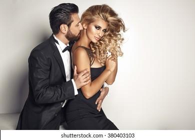 Handsome man cuddling his beloved woman