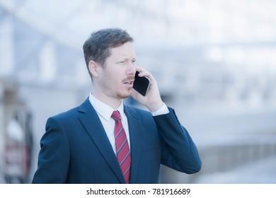 Handsome man in a dark blue business suit