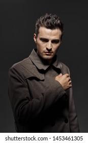 Handsome man in a dark shirt elegant style charm self-confidence model
