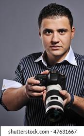 Handsome man with a digital camera