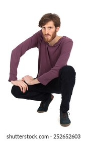 Handsome man doing different expressions in different sets of clothes: kneeling