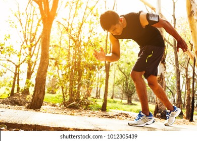 handsome man doing exercises and warm up before run and Physical fitness test ; Healthy lifestyle cardio together at outdoors summer