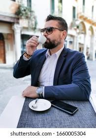 Handsome man drinking espresso in Verona