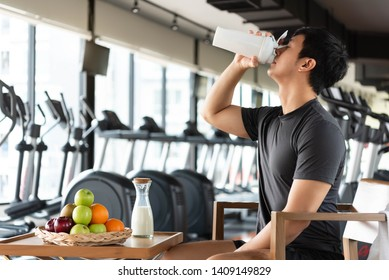 Handsome man drinking protein shake milk and many kind of fruits for nourishing body daily. People lifestyles and Nutrition food concept. Nutrition of sport man theme.