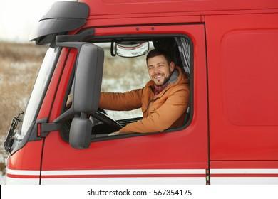 Handsome man driving big modern truck