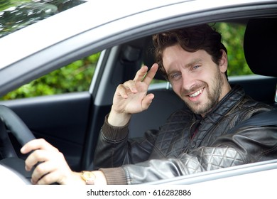 Handsome man driving car serious