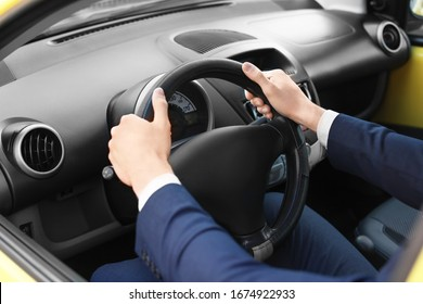 Handsome man driving taxi car