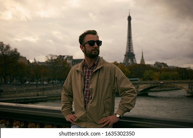 Handsome man enjoying in Paris.