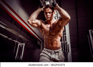 Handsome man exercising doing abdominal exercise in gym.
