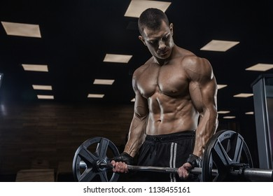 A handsome man is exercising in a modern gym