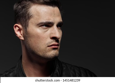 Handsome man face closeup fashionable hairstyle sexy look portrait courage beard