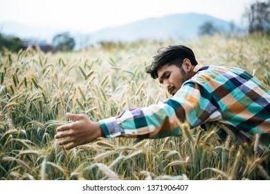 Handsome man farmer with barley field