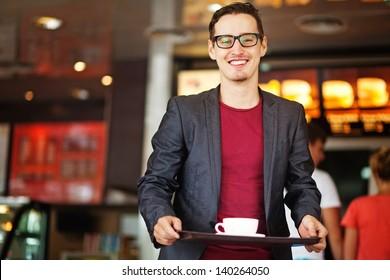 handsome man in fastfood restaurant