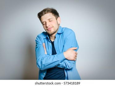 Handsome man fell asleep cozy, isolated on a gray background