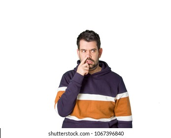 Handsome man with finger in nose