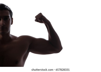 Handsome man flexing his muscles on white