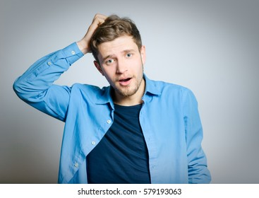 Handsome man forgot something to do, isolated on a gray background