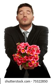 Handsome man is giving bouquet of pink flowers, isolated on white background