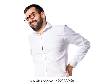 Handsome man with glasses with back pain