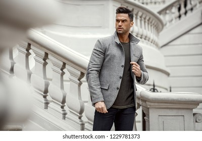 Handsome man in gray jacket