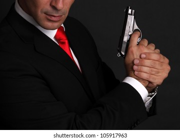Handsome man with gun elegant spy
