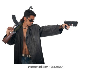 Handsome man with gun in leather raincoat. Isolated on white background.