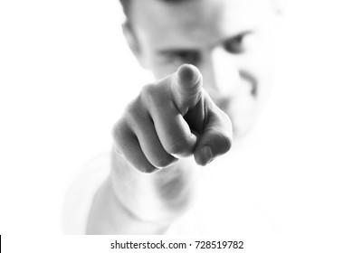 Handsome man, guy pointing to the front, at you, at white background, call to action, motivation