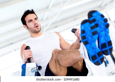 Handsome man at the gym working out