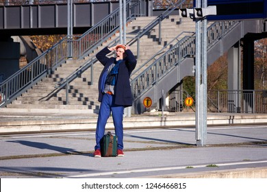 handsome man in his 50s waiting at train station and looking angry