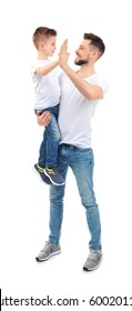 Handsome man with his son on white background