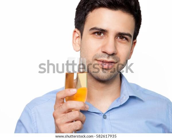 Handsome man holding champagne flute