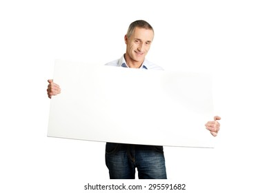 Handsome man holding an empty banner.