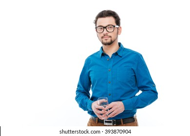 Handsome man holding glass with water isolated on a white background