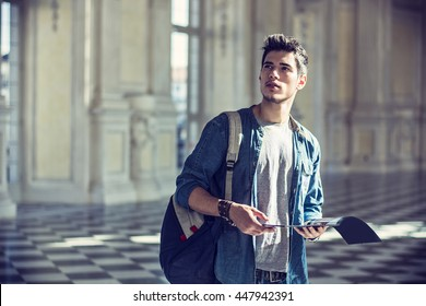 Handsome Man Holding a Guide Inside a Museum