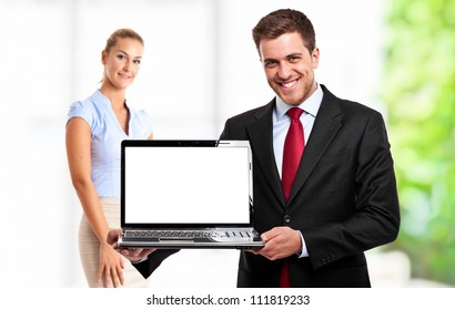 Handsome man holding a laptop