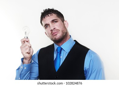 handsome man holding a light bulb in his hand
