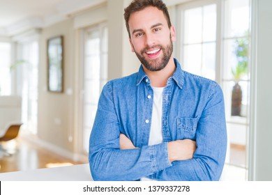 Handsome man at home happy face smiling with crossed arms looking at the camera. Positive person.