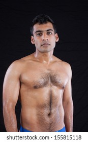 Handsome Man From India Standing Shirtless With Hair On His Chest And Well Defined Muscles
