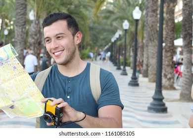 Handsome man joyfully exploring a city with copy space