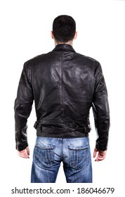 Handsome man in leather jacket, rear view on back. Isolated on white