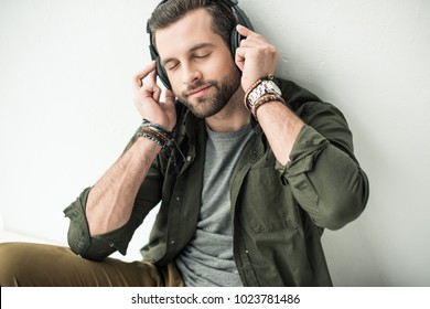 handsome man listening music with closed eyes