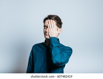 Handsome man made a mistake, isolated on a gray background