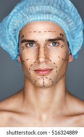 Handsome man in medical hat with pencil marks on skin for cosmetic surgery, ready for operation. Aesthetic Cosmetology concept