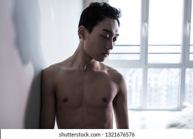 Handsome man or muscular macho, bodybuilder, with sexy, muscle torso, body