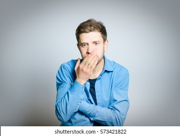 Handsome man nauseated, isolated on a gray background