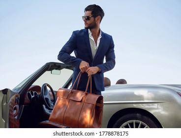 Handsome man near the car. Businessman.